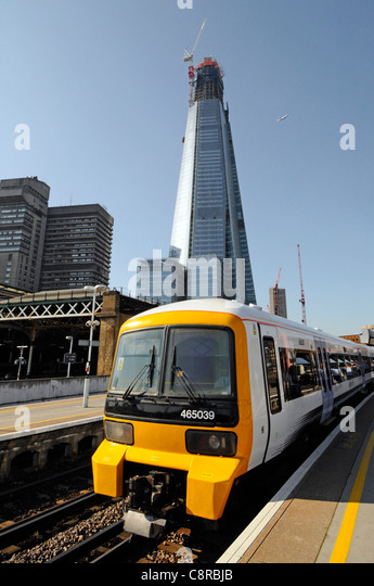 London Bridge train station with The Shard building and Guys Hospital beyond - Stock Image