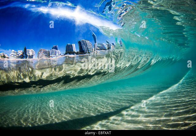 Australia, Gold Coast, City view through wave - Stock Image