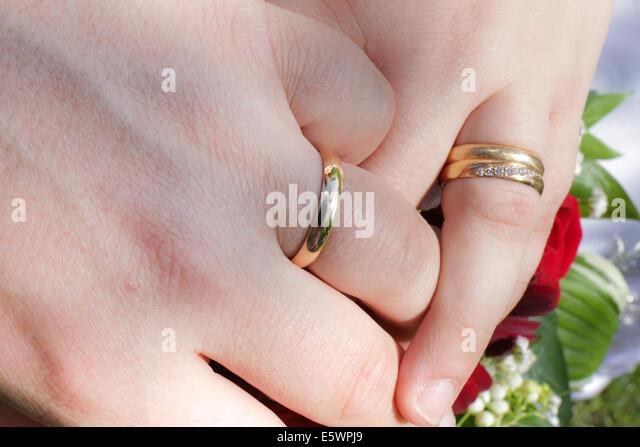 Newlyweds holding hands - Stock Image