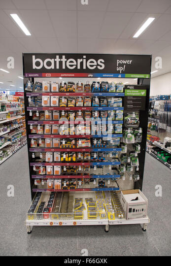 Batteries for sale on a shelf in a DIY store. - Stock Image
