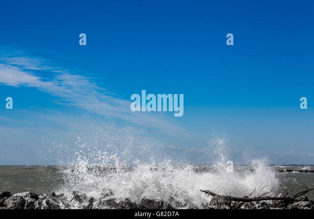 Crashing Wave on the rocks in Italy - Stock Image
