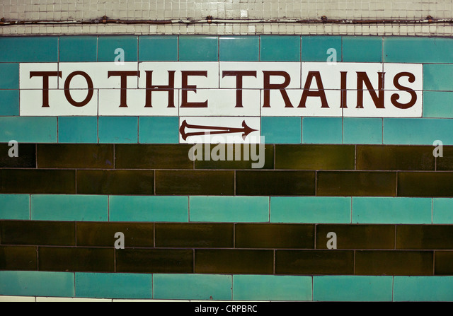 To the trains sign in an underground station, London, England, UK - Stock Image