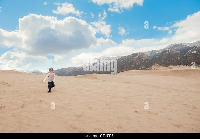 Boy running, Great sand dunes national park, Colorado, America, USA - Stock Image