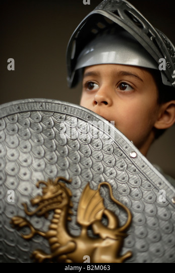 Six year old boy wears plastic armour - Stock Image