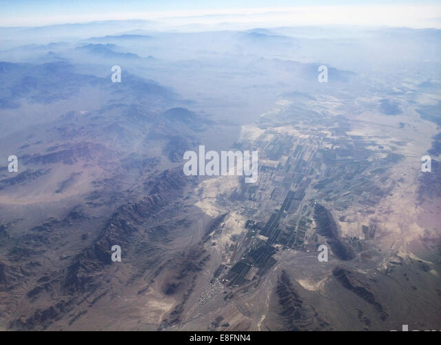 Agricultural land and mountain range - Stock Image