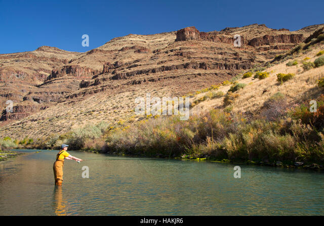 woman wading in river stock photos woman wading in river stock images alamy. Black Bedroom Furniture Sets. Home Design Ideas
