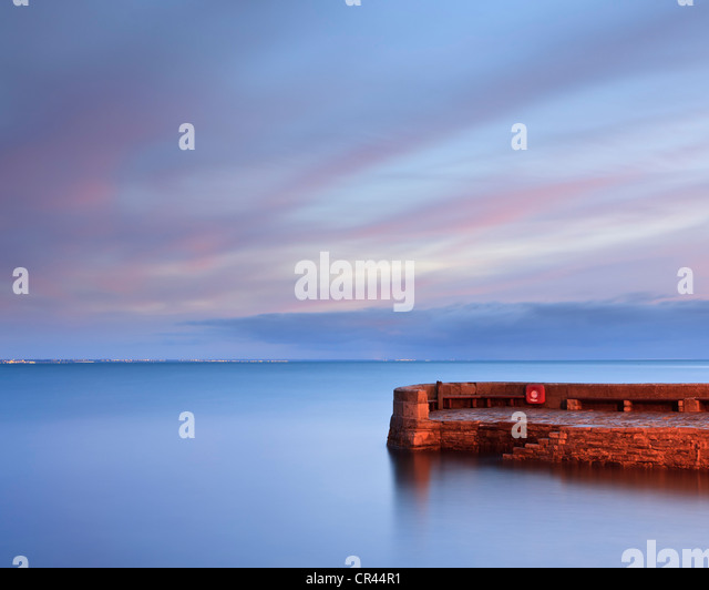 The Old Stone Quay at Swanage, Dorset, UK, at dawn - Stock Image
