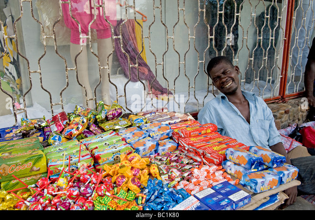 Street hawker selling sweets Quelimane Mozambique - Stock Image