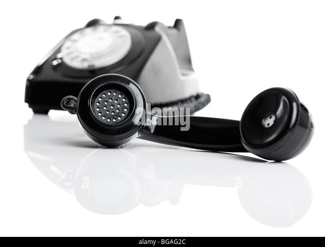 Nice vintage telephone perfectly isolated on white background, focus is on the handset - Stock Image