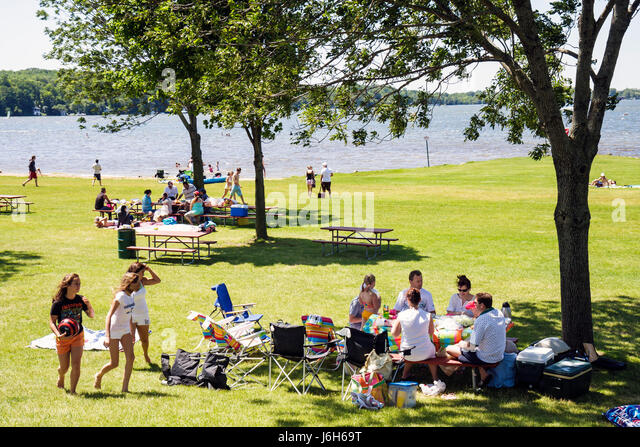 Wisconsin Kenosha Silver Lake Silver Lake Park picnic benches girls teen family outdoor fun summer vacation men - Stock Image