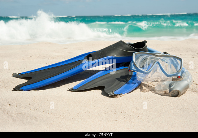 Snorkelling equipment at water's edge, Mustique, Grenadine Islands - Stock Image