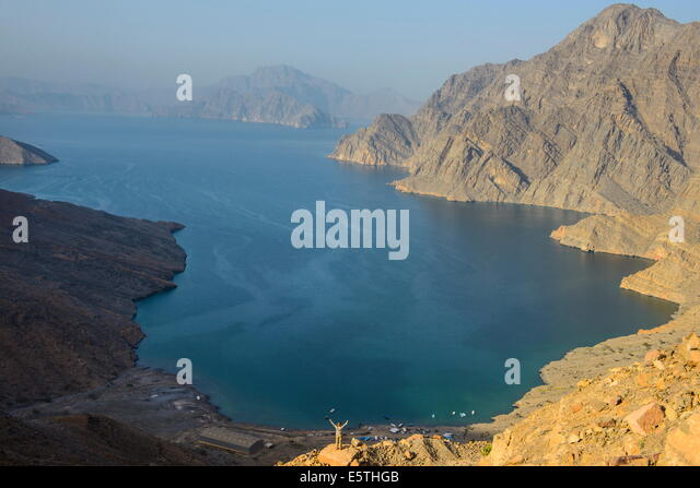 Woman at a viewing point over the Khor An-najd fjord, Musandam, Oman, Middle East - Stock Image