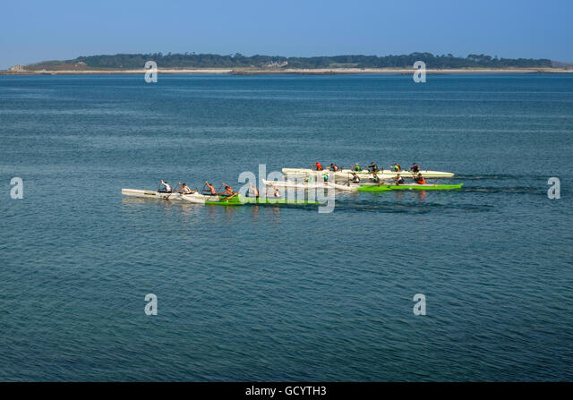 Three boats race in the challenging Celtic Crossing outriggers  race from St Mary's Scilly Isles to Sennen, Cornwall, - Stock Image