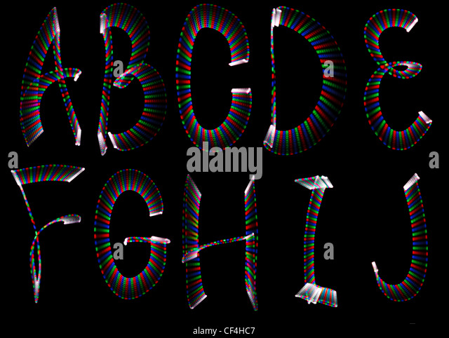 Bright rainbow letters, part of english alphabet on black background. Isolated. - Stock Image