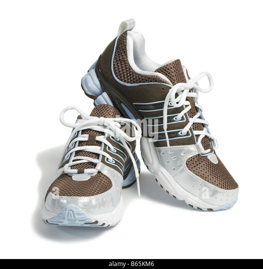 Brown Adidas running shoes - Stock Image