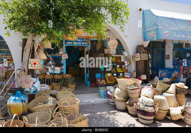 Shops selling spices and wicker baskets in the village of Guellala, Djerba, Tunisia - Stock Image