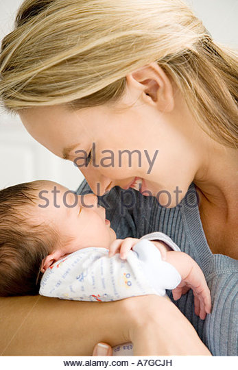 Mother holding her young baby - Stock-Bilder