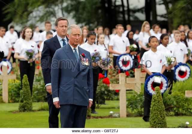 Britain's Prince Charles (R) and British Prime Minister David Cameron attend a ceremony in the cemetery at the - Stock-Bilder