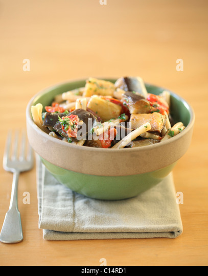 Pasta with tomatoes and eggplant - Stock Image