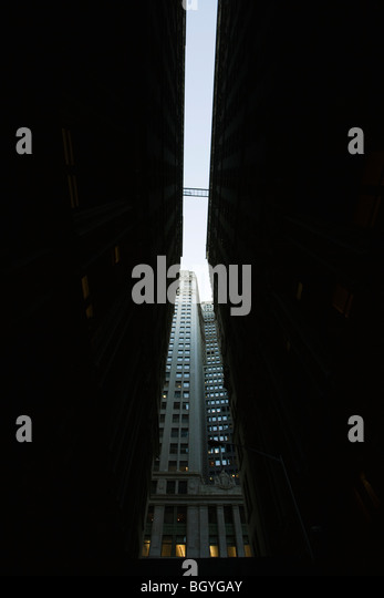 High rise seen at end of narrow alley, low angle view - Stock Image