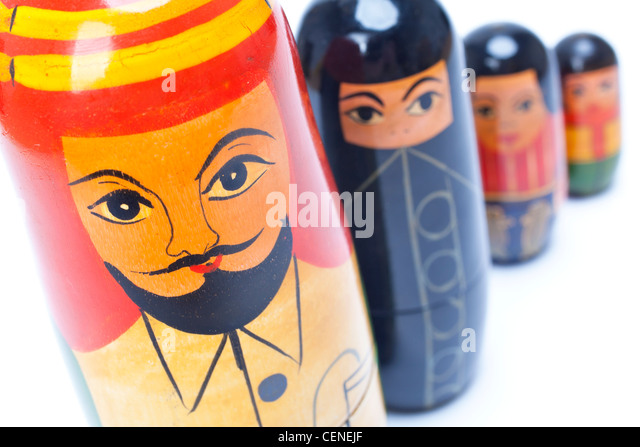 Arab Islamic Muslim man woman & children family nesting dolls in close up, the woman is wearing a black burka - Stock Image