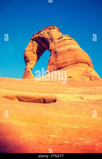 Vintage toned Delicate Arch at sunset, Utah, USA. - Stock-Bilder