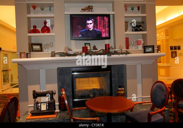 Maine Freeport Hilton Garden Inn motel hotel lobby fireplace decor decoration flat screen panel TV - Stock Image