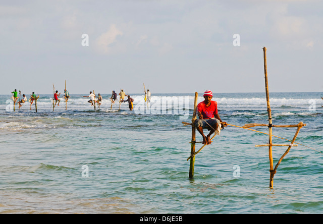 Stilt fishermen, Dalawella, Sri Lanka, Indian Ocean, Asia - Stock Image