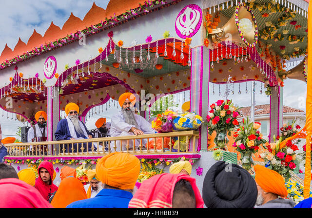 Colourful Parade float carrying the holy scripture, Guru Granth Sahib, the 11th Guru of the Sikhs. Vaisakhi - Stock Image