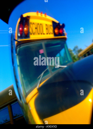 Yellow School Bus from Distorted Angle on a Bright Sunny Day - Stock Image