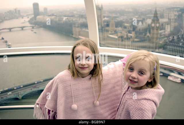 Photograph of London Eye visit view pod inside kids river thames - Stock-Bilder