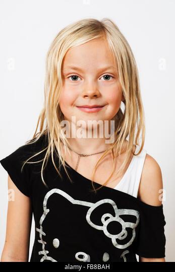 Portrait of smiling blonde girl (6-7) - Stock Image