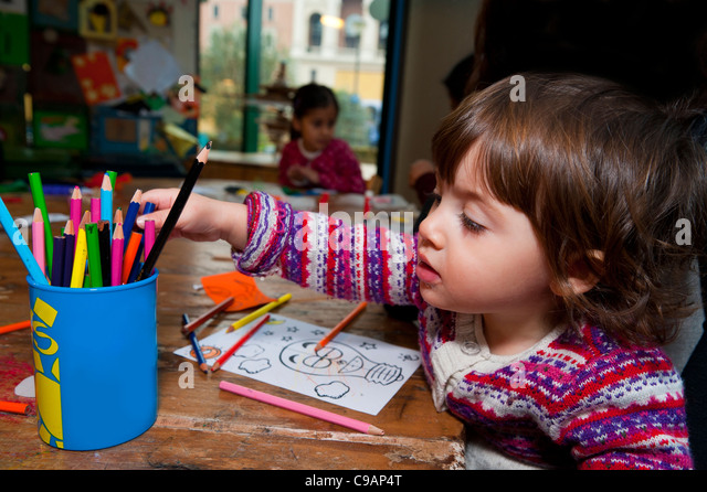 Little girl drawing - Stock Image