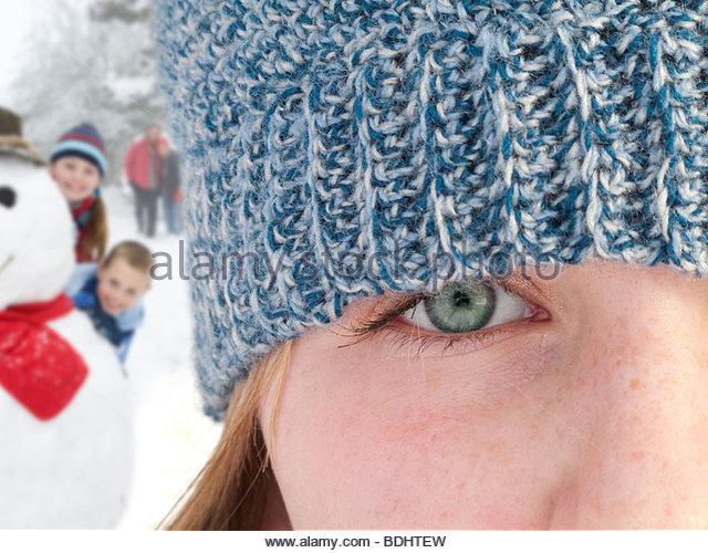 Close up of teenage girl wearing knit hat - Stock Image