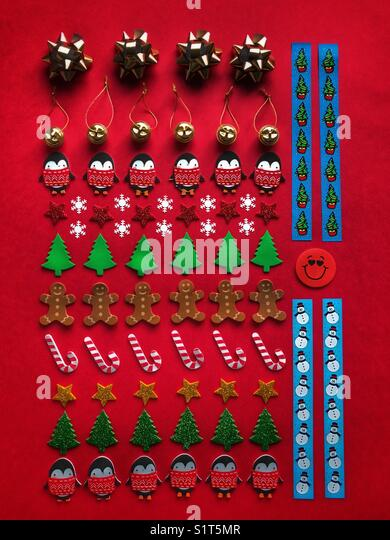 Christmas themed flat lay on red background. - Stock Image
