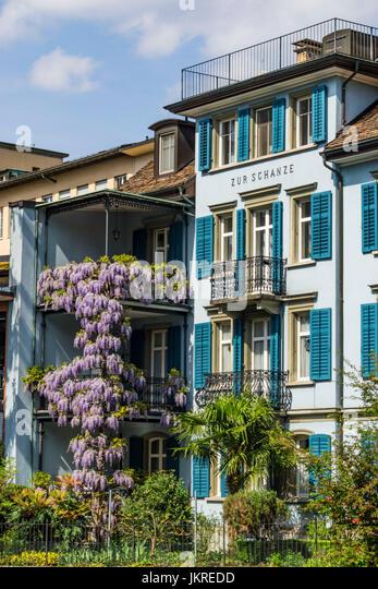 Balcony with flowers, old city center, Zur Schanze, Zurich, Switzerland - Stock Image