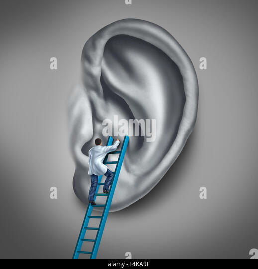 Ear medicine medical concept as a doctor or health specialist treating the human hearing organ as a physician performing - Stock-Bilder