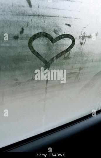 Heart shape on car window - Stock Image