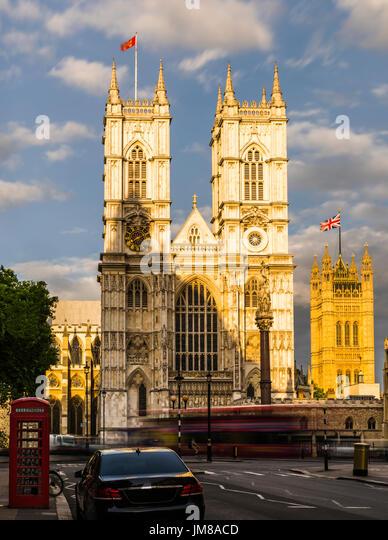Setting sunlight over Westminster Abbey, Westminster, London, UK - Stock Image