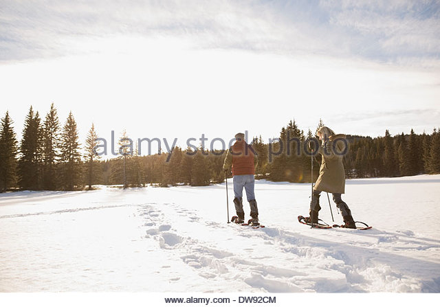 Mature couple snowshoeing - Stock Image