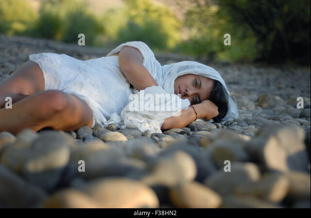 Exotic girl Arabian look like green eyes laying down on the floor - Stock Image