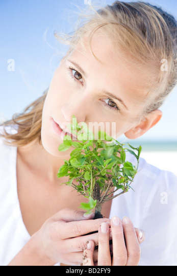 Woman with bonsai tree - Stock Image