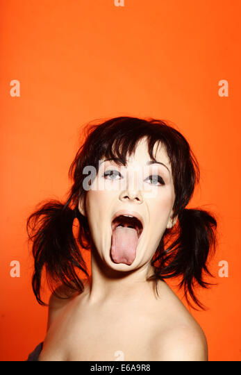 sticking out tongue,grimace,silly - Stock Image