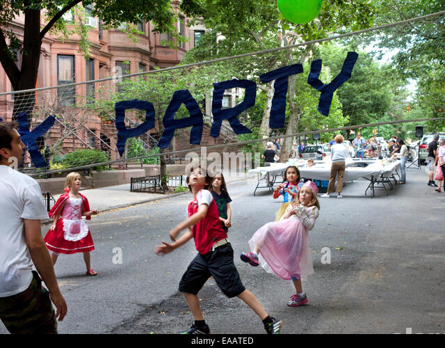 playing volleyball at a Brooklyn Block Party - Stock Image