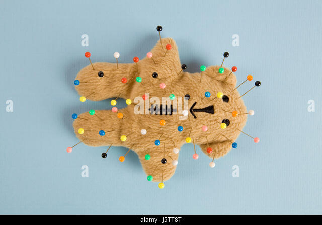 a quirky teddy bear like a voodoo doll isolated - Stock Image