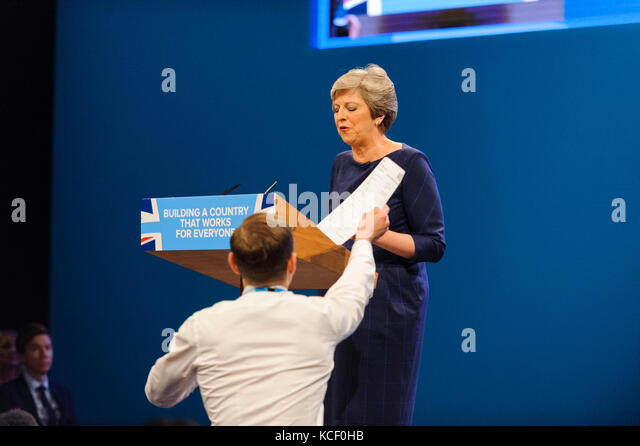 Manchester, UK. 4th October 2017. Handing a spoof P45 to the PM, Prankster, Simon Brodkin, distrupted the Prime - Stock Image
