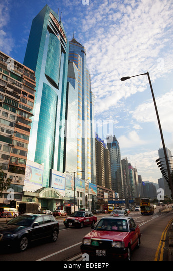Traffic in front of high rise buildings in Causeway Bay, Hong Kong, China. - Stock-Bilder