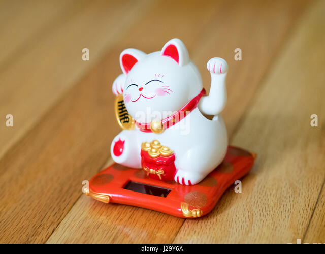 A maneki-neko (literally, 'beckoning cat' in Japanese, also known as a lucky cat, Chinese lucky cat, or - Stock Image