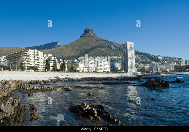 Sea Point is the only high rise area available along the entire Cape Town shoreline Lions Head 669 m in the back - Stock Image