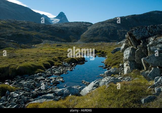 The peak of Nîniartivaraq (1295m), Sermilik Fjord, East Greenland - Stock Image